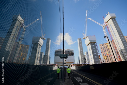 Tall buildings on a construction sitereflected on glass in Wembley, London Wallpaper Mural