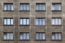 Many Windows In Row On Facade Of Urban Apartment Building Front View, St. Petersburg, Russia.