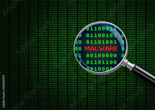 Fotografía  Magnifying glass enlarging malware in computer machine code