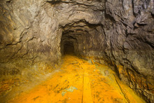 Old Abandoned Iron Mine Tunnel Passage With Yellow Brimstone