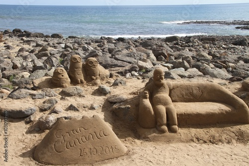 Sand statue of funny cartoon characters Canvas Print