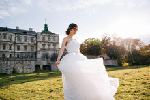 Elegant Stylish Sweet Young Beautiful Happy Bride In Amazing Wedding Dress Stands On The Old Palace. Wedding Day