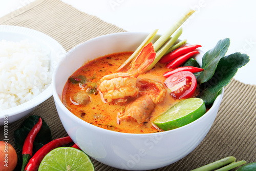 Thai Prawn Soup with Lemongrass (Tom Yum Goong) with Rice On Brown Cloth Background.