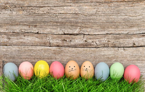 Plakat  Funny easter eggs in green grass. Cute decoration