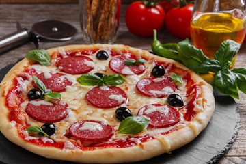 Obraz na Plexipizza with salami tomato and cheese