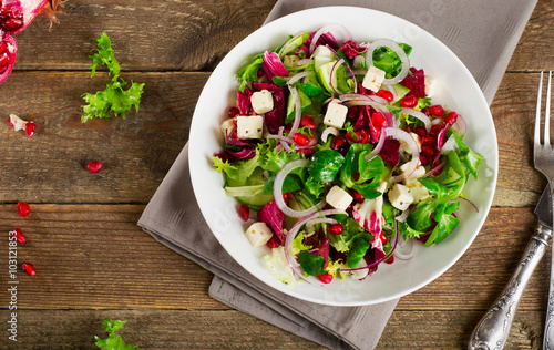 Fresh green salad with feta cheese and pomegranate. Slika na platnu