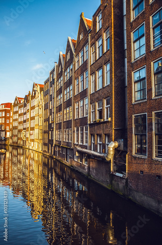 Photo  AMSTERDAM, NETHERLANDS - JANUARY 15, 2016: Famous buildings of Amsterdam city centre close-up at sun set time