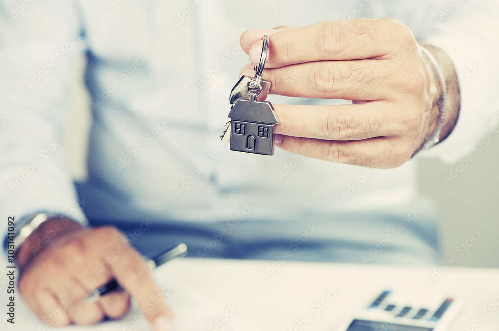 Fototapeta Hand with a house key