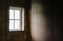 Soft Natural Light Coming Through Barn Window To Brighten Barn Board Interior.