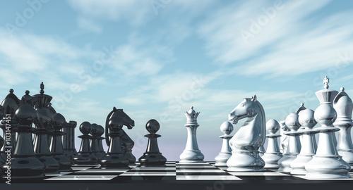 Valokuva Chess, arranged under the open sky on a chessboard