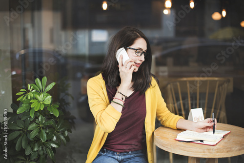 Foto  Woman Calling Smart Phone Writing Concept