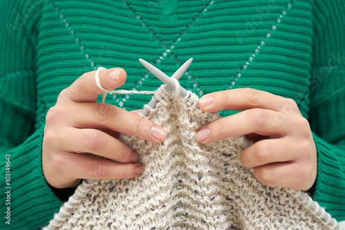 Fotografie, Obraz  Close-up of young woman hands, knitting scarf