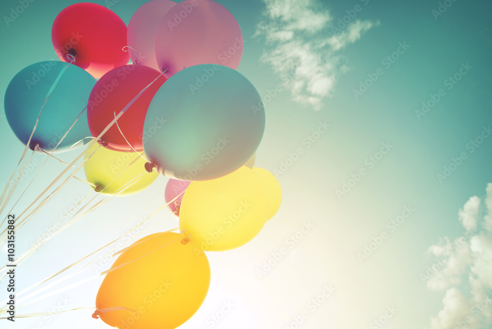 Fotografie, Obraz Multicolor balloons in summer holidays. Pastel color filter