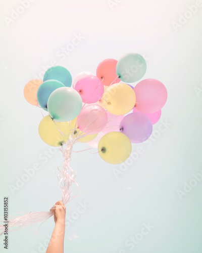 Woman hand holding colorful balloons Wallpaper Mural