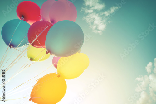 Photo  Multicolor balloons in summer holidays. Pastel color filter