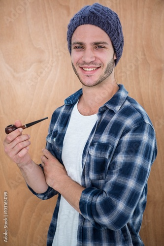 Handsome hipster smocking a pipe - Buy this stock photo and explore