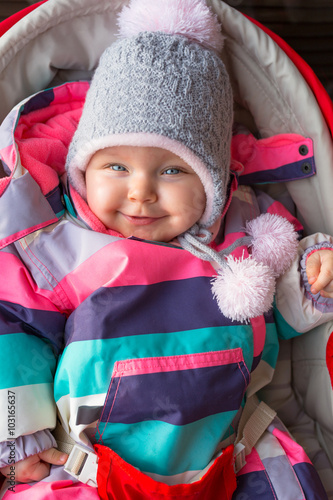 4ac2821f7 Portrait of baby girl in winter jacket and hat - Buy this stock ...