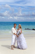 The groom and the bride on the tropical beach.