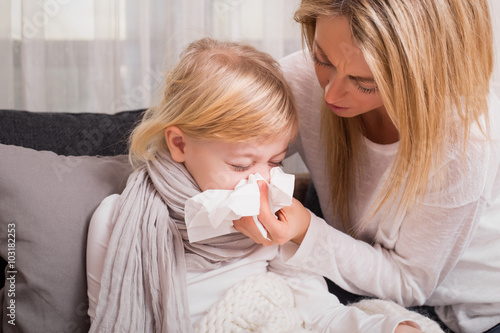 Fotografia, Obraz  Mother helping her child to blow her nose
