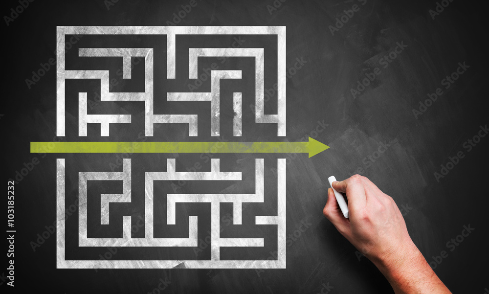 Fototapeta hand drawing a shortcut to a maze on a chalkboard