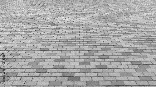 Perspective View Of Monotone Gray Brick Stone Street Road Sidewalk Pavement Texture Background