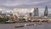 Slow Motion Shot Of The Skyline Of The City Of London Across The River Thames, Showing Blackfriars Station And St Paul's Cathedral