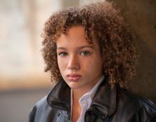 Biracial Tween Boy In Leather Jacket