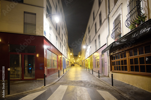 Poster Paris Paris, France, February 9, 2016: view of a street in a center of Paris, France in a night