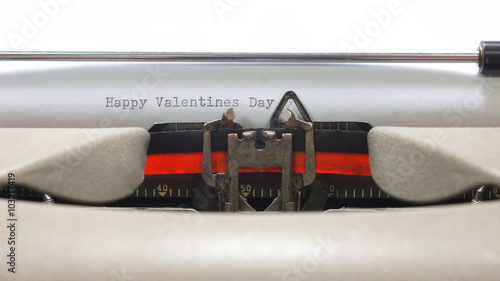 Foto op Aluminium Happy Valentines Day. Message written on old typewriter on white paper