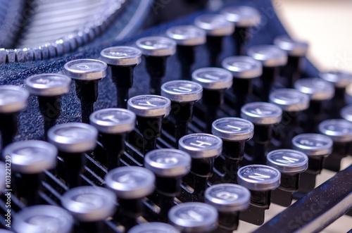 Fotografie, Obraz  Typewriter Writing / Close-up of a vintage, retro typewriter.