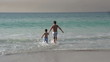 2 young boys running into the sea, Cape Town,South Africa