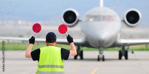 Photo  Air traffic controller holding signs