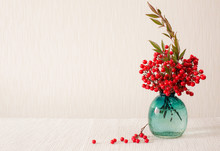 Japanese Vase With Red Berries Of Sacred Bamboo (Nandina Domestica). (Place For Text)