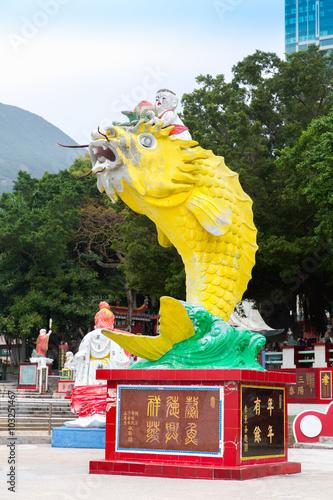 Fototapeta Big Yellow Fish Statue in Guan Yin Temple at Repulse Bay, Hong Kong