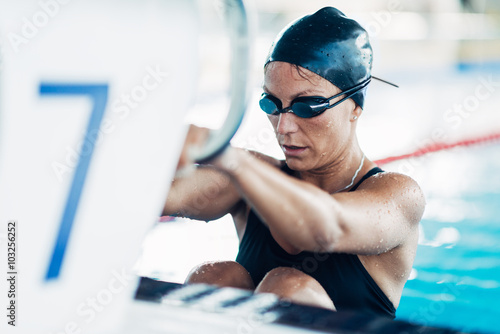 Backstroke swimmer at the swimming block, ready to start the race Wallpaper Mural
