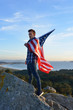 Man Holding a USA Flag on a Hill