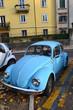 Blue retro car parked.