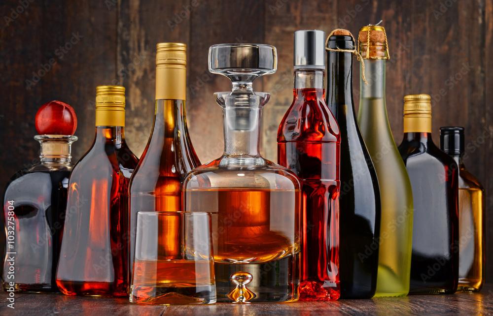 Fototapeta Bottles of assorted alcoholic beverages
