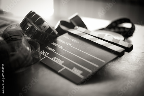 Movie clapper board and filmstrip selective focus Canvas Print