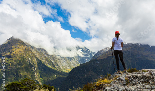 Fototapeta Woman hiker enjoys the view of Key Summit with Ailsa Mountain at