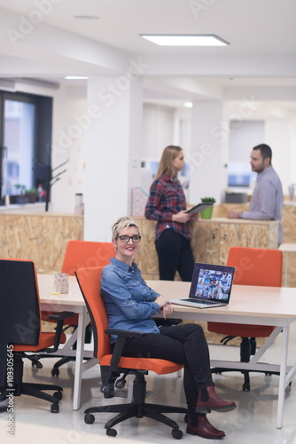 Fototapety, obrazy: portrait of young business woman at office with team in backgrou