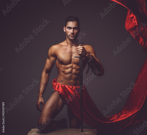 Fényképezés  A man holding a sword.