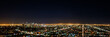 Panorama long exposure night view of Los Angeles downtown and surrounding metropolitan area from Hollywood hills