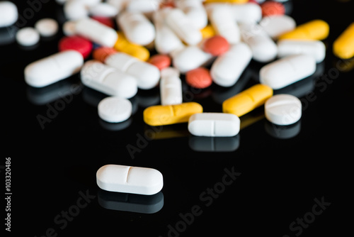 perspective view to drug pills on black background