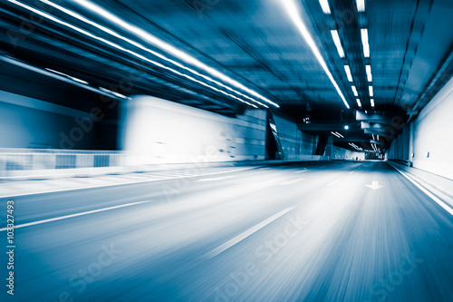 Fotobehang Luchthaven Blue color tunnel car driving motion blur