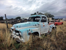 Abandoned Old Truck In Overgrown Field - Landscape Color Photo