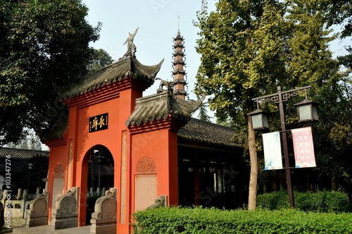 Poster Temple Chengdu, China - November 8, 2010: Coral-coloured entrance gate into the pagoda courtyard at the historic Wenshu Buddhist temple