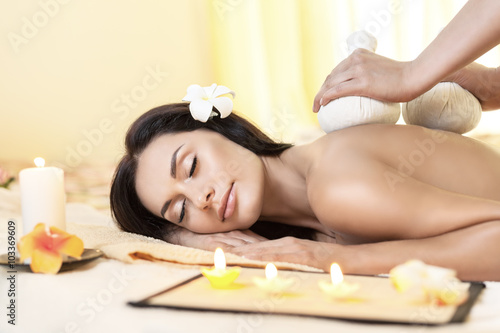 Young woman getting massage in Thai spa. Poster