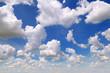 Leinwandbild Motiv cumulus clouds in the blue sky