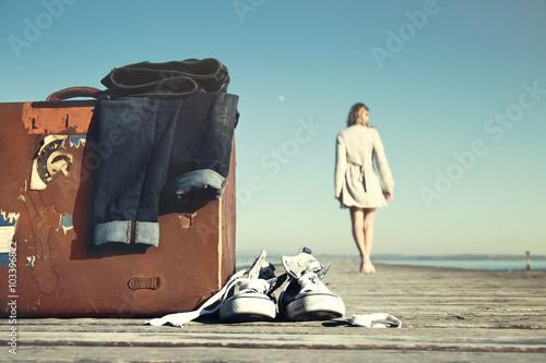 adventurous woman is walking toward its destination Tablou Canvas